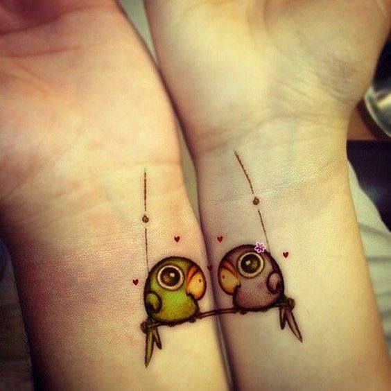matching parrot tattoos