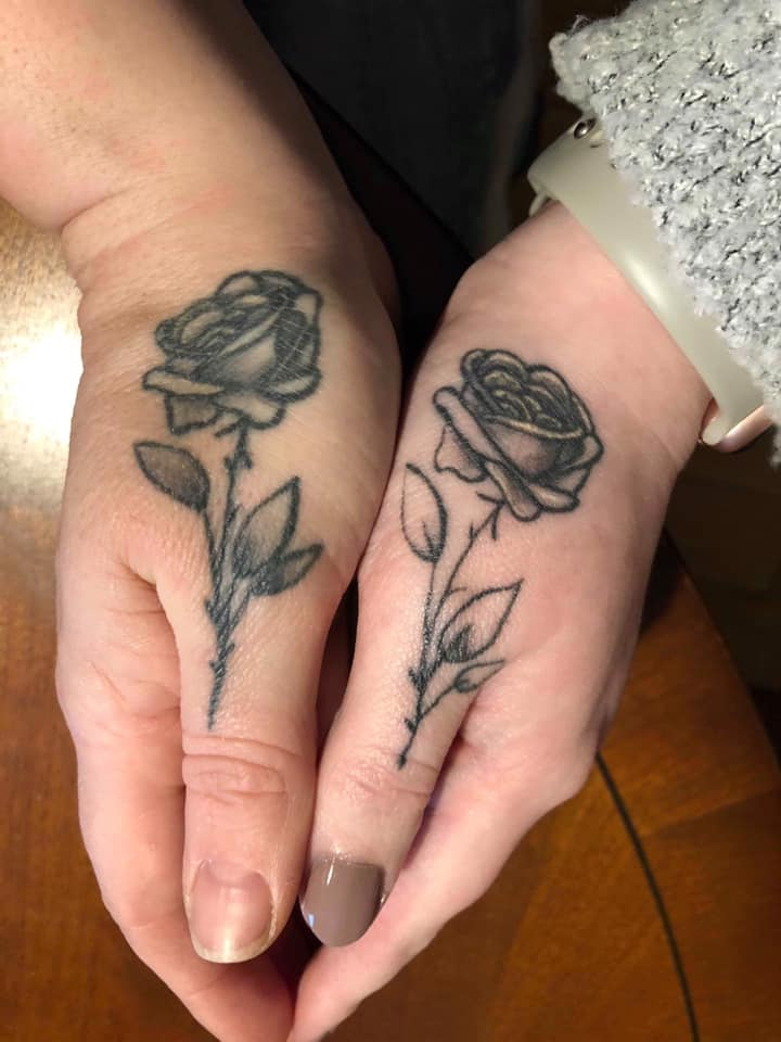 matching rose tattoos