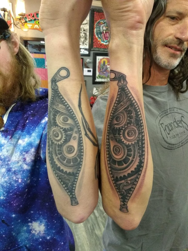matching zipper tattoos