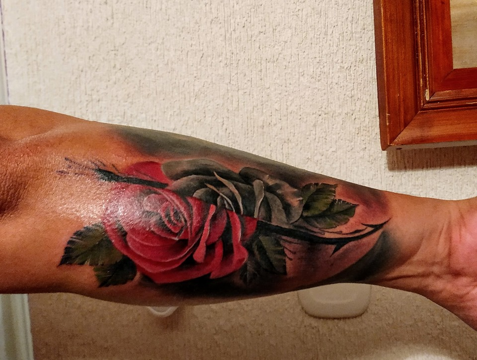 rose forearm tattoo