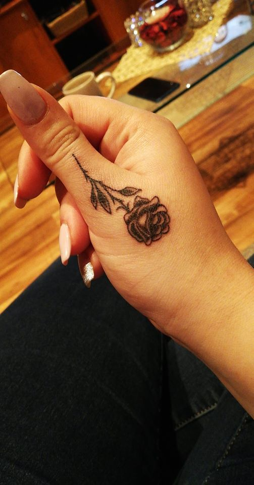 rose thumb tattoo