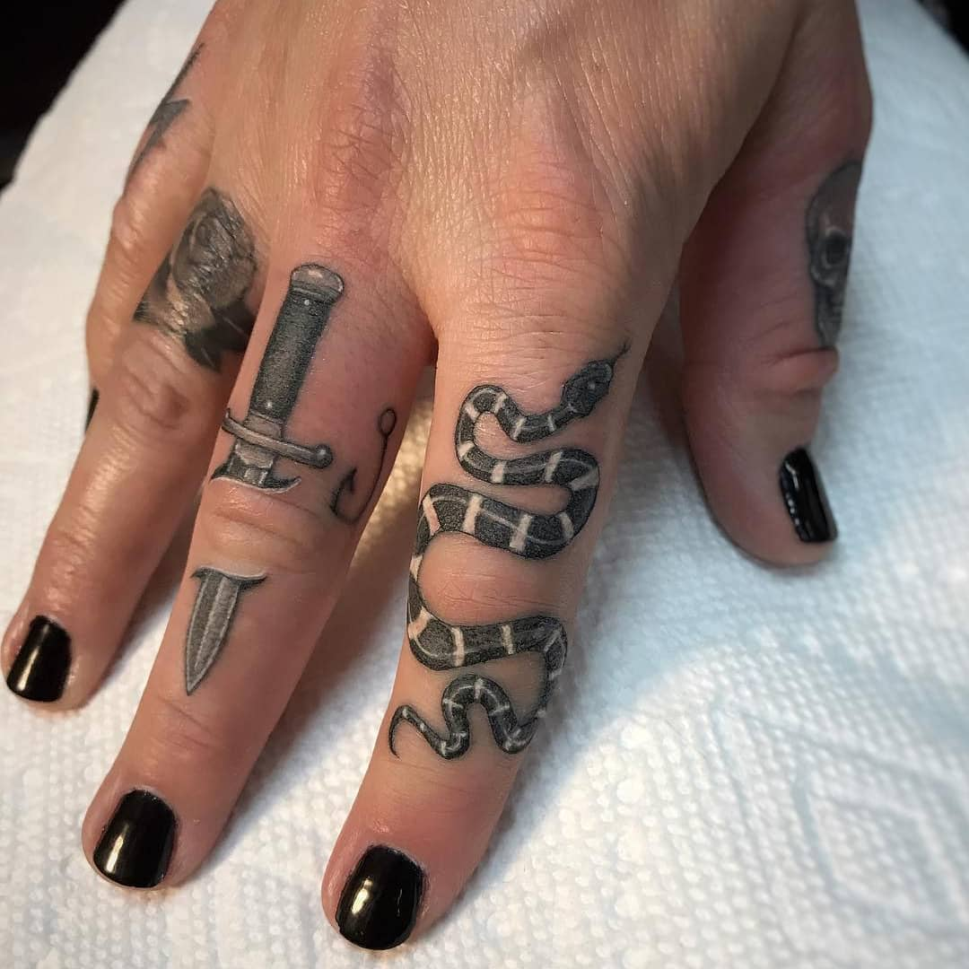 Finger Tattoos by Ben Grillo.