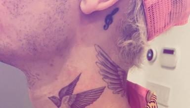 justin beiber neck tattoo